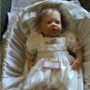 Value of an Ashton Drake Doll - baby doll wearing a long gown
