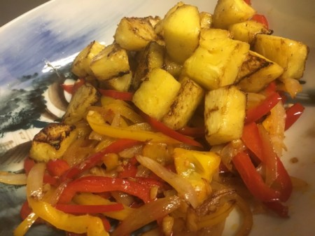 Pineapple added to Peppers and onions in bowl