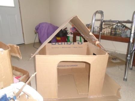 Making a Cardboard Dog House - begin gluing on roof