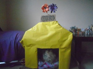 Making a Cardboard Dog House - write dog's name on a piece of cardboard and glue on, cover the front with paper if desired