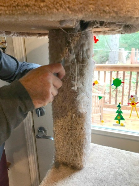 Refinishing a Cat Tree - cutting away old carpet with box knife
