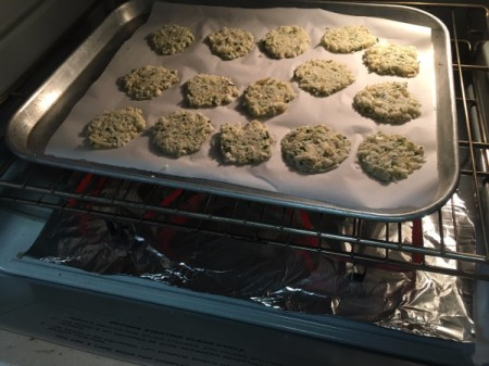 unbaked Cauliflower Cheese Crisps in oven