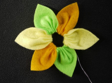 Felt Flower Brooch - gently pull the thread to gather the petals and secure with a backstitch
