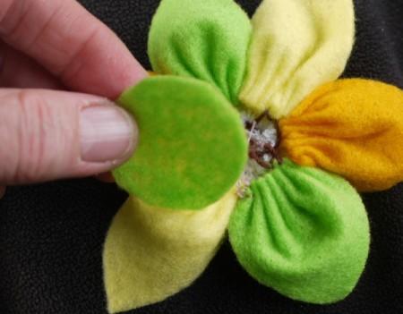 Felt Flower Brooch - cut a circle of felt to fit the back