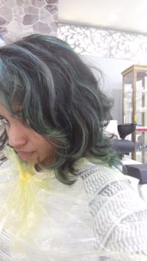 Hair has been dyed and has turned a greenish color.