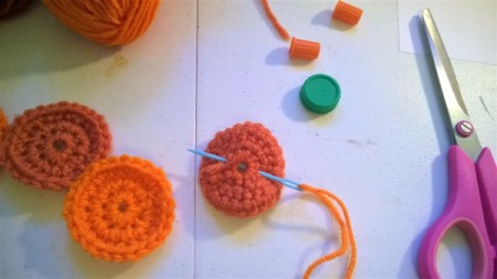 Cute Little Crochet Circle Pumpkin - use double yarn threaded on needle to stitch circles together
