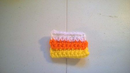 Crocheted Candy Corn Butterfly Magnet - three rows completed