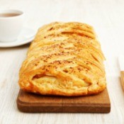 Stuffed breakfast bread braid on a cutting board.