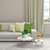 Green and Beige Throw Pillows on Couch