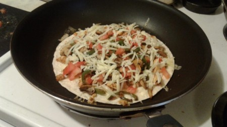cheese on ingredients on tortilla