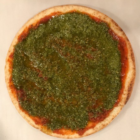 Store-bought pizza crust with herb sauce.