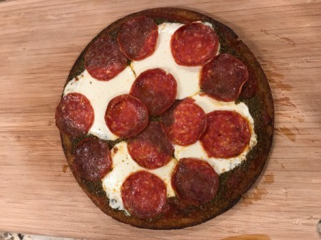 A cooked pizza made from store-bought crust.