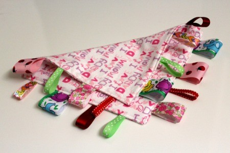 Baby Tag Blankets - back and front of one in pink