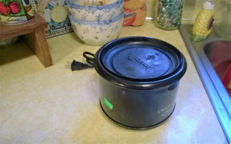 A replacement lid for a mini crockpot from a plastic bowl.