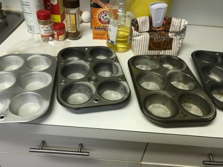 greased muffins tins