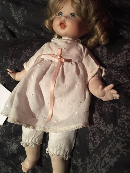 Identifying a Porcelain Doll - doll wearing a pink dress