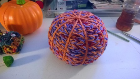 Yarn Bombed Pumpkin - keep wrapping to the bottom, but do not cover the bottom. Make a chain from the burnt orange to highlight the ridges and wrap