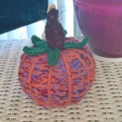 Yarn Bombed Pumpkin - pumpkin on tabletop