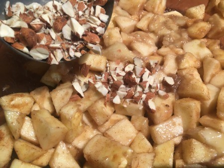 adding almonds to apples