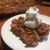 Healthy Apple Crisp on plate with whipped cream