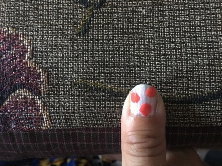 Quick Marbled Nail Art - one nail at t a time paint on a second coat of base and add three dots of a new color