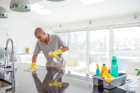 Man Cleaning a House