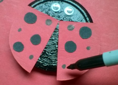 Recycled Metal Lid Ladybird (Ladybug) Wall Decoration - adding smaller dots with the marker