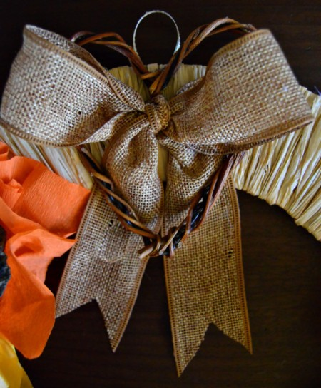 Lotus Pod and Crepe Paper Fall Wreath - hot glue the bow and the twig heart to the wreath
