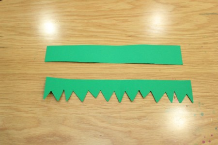 Halloween Frankenstein Soda Bottle Craft - cut jagged bottom on green paper strip for hair