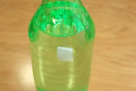 Halloween Frankenstein Soda Bottle Craft - tape square on bottle