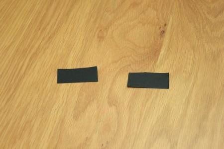 Halloween Frankenstein Soda Bottle Craft - black rectangles for eyebrows