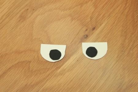 Halloween Frankenstein Soda Bottle Craft - glue pupils to eyes