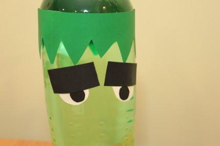 Halloween Frankenstein Soda Bottle Craft - tape eyes to bottle just below the hairline