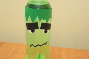 Halloween Frankenstein Soda Bottle Craft - tape mouth in place