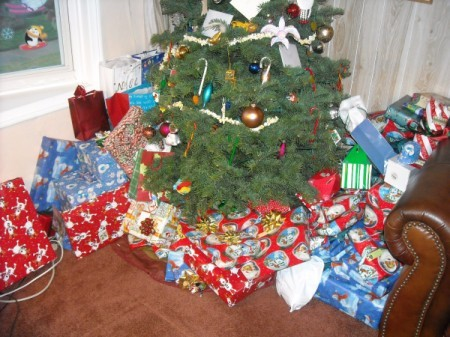 A Christmas tree with wrapped presents underneath.