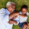 Happy Grandfather and Grandson in Grass
