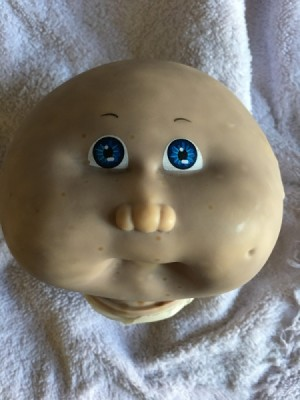 Cleaning a Cabbage Patch Kid's Head - discolored doll's head