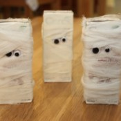 3 juice boxes wrapped to look like mummies.