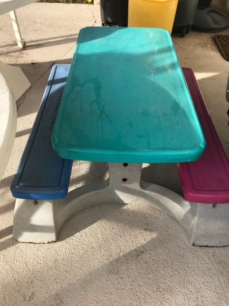 A colorful plastic table for children, found on the curb.