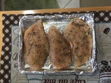 Seasoned Chicken Breasts on baking train