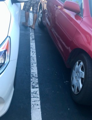 Two cars parked in a parking lot.