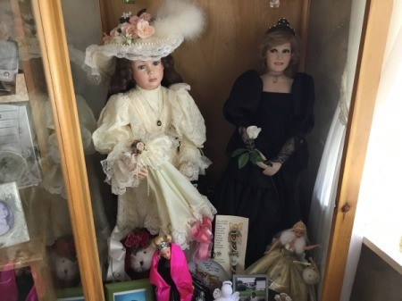 Value of Doll Collection - two dolls in a glass case