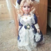 Identifying a Porcelain Doll - doll wearing a blue and white outfit