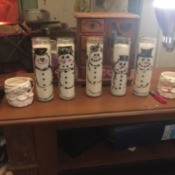 Waving Snowman Candles - several snowman candles  on table top