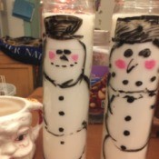 Waving Snowman Candles - finished drawings on two of the candles