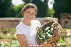 Woman With Summer Squash Harvest
