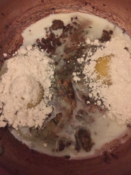 adding flour to eggs in skillet