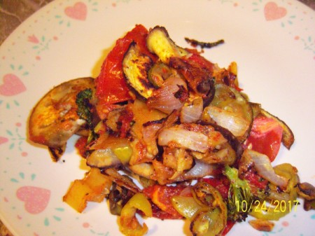 A plate of vegetables roasted in the oven.