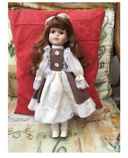 Identifying a Doll and Finding Its Value - auburn haired doll wearing a white and mauve dress and lace up shoes