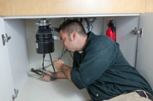 Man Replacing a Leaking Garbage Disposal